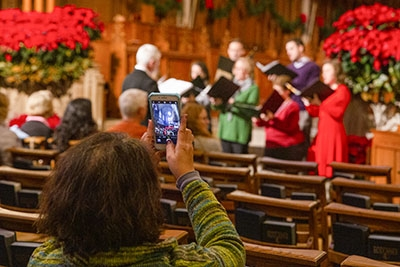 A visitor takes a photo at the Christmas Open House